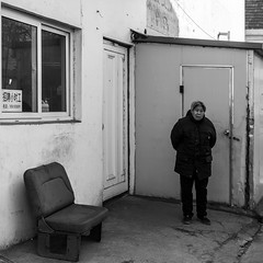Yes my dear (Go-tea 郭天) Tags: old lady woman grandma granny cold winter shadow seat stand waiting wait alone lonely qingdao huangdao door house dirty sofa chair window heavy coat guard guardian lost street urban city outside outdoor people bw bnw black white blackwhite blackandwhite monochrome asia asian china chinese shandong canon eos 100d 24mm prime