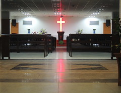 Inside an empty Christian church in China (Hefei) (Germán Vogel) Tags: hefei asia eastasia china anhui travel traveldestinations traveltourism tourism touristattractions interior inside church temple religion christianity christian religioninchina christianityinchina centralisle vanishingpoint sermon pulpit empty nopeople cross seat bench