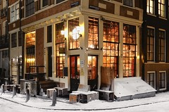 Inviting warm and cosy café 't Papeneiland (B℮n) Tags: café papeneiland amsterdam brouwersgracht snow covered bikes bycicles holland netherlands canals winter cold wester church jordaan street anne frank house dutch people scooter gezellig cafés snowy snowfall atmosphere colorful windows walk walking bike cozy boat light rembrandt water canal weather cool sunset celcius mokum pakhuis grachtengordel unesco world heritage sled bycicle 1°c sun shadows sneeuw brug slippery glad night flakes evening handheld bankje fairytale mist prinsengracht lekkeresluis noordermarkt bruin kroeg 50faves topf50 100faves topf100