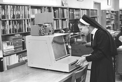 New Microfilm Reader at Library (TBayMuseum) Tags: nuns catholic libraries interior technology ontario canada history thunderbay microfilm women womenshistory dailytimesjournal fortwilliam media newspapers