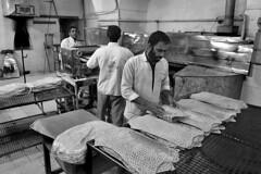 Iran - Kashan (luca marella) Tags: iran kashan street social documentary reportage lucamarellacom black white bianco e nero bw bn bread culture shop monocromo persone