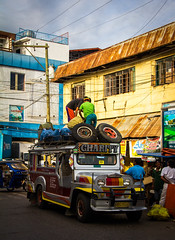 Puerto Princesa, Philippines - February 17, 2015: City life and food market (AlfonsoFD) Tags: motorbike authentic canoneos asia canon60d people chaos city 2015 canon philippines elnido busy bohol travel truck cars bikes town street streets puertoprincesa