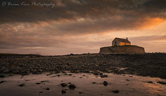 St Cwyfan's Church (.Brian Kerr Photography.) Tags: anglesey wales stcwyfanschurch llangwyfan seascape landscape photography a7rii availablelight sony orange sunset church briankerrphotography briankerrphoto outdoor outdoorphotography welsh beach shore reflection clouds sky warmth mountains snowdonia beautiful cold lastlight sea sand