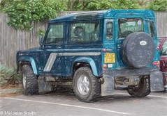 Land Rover Defender 90 (M C Smith) Tags: landrover green parking pentax kp fence trees car