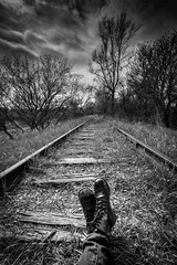 Exporation (Explore - 20-4-17) (G Srubas) Tags: abandoned railroad track tracks train grass grasslands scenic perspective monochrome contrast black white bw shoes boots combat photography self portrait gabbypike