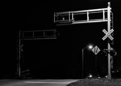 This much madness is too much sorrow (fallsroad) Tags: road street longexposure railroad blackandwhite bw monochrome night mono crossing jenksoklahoma nikond7000
