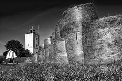 Hay Bales Lighthouse (Alfred Grupstra Photography) Tags: trees light sky blackandwhite bw grass clouds landscape nikon hay bales