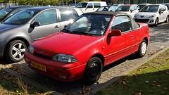 Suzuki Swift 1.3 Cabriolet (sjoerd.wijsman) Tags: auto red holland cars netherlands car nederland thenetherlands convertible delft voiture vehicle holanda autos rood cabrio paysbas olanda fahrzeug niederlande cabriolet zuidholland tudelft carspotting redcars suzukiswift carspot suzukiswiftconvertible swiftcabriolet suzukiswiftcabriolet sidecode5 nrnr91 suzukiswiftcabrio swiftcabrio swiftconvertible