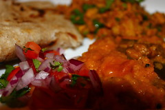 Vegetable daal,keema served with chapati and a tomato and onion salad (WorldClick) Tags: life food canon eos photo yummy flickr photographer indian spice salt perspective vivid vegetable powder east photograph delight aubergine pakistani chilli capture turmeric cumin eastern haldi flavour daal cusine jeera keema phototgraphy dhaniya 1100d zeera canoneos1100d worldclick vegetabledaal keemaservedwithchapatiandatomatoandonionsalad