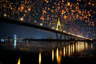 Floating lantern over bridge at night