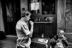 Hungry man (Yarin del Vecchio) Tags: street old white man black men portugal pub eat porto talking