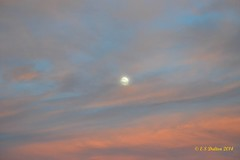 October 6, 2014 - As the moon rises in the east, the setting sun colors the clouds in Thornton. (Ed Dalton)