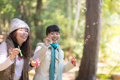 Super happy sister playing with soap bubbles in green forest (Apricot Cafe) Tags: img29278 3039years asia asianandindianethnicities canonef85mmf18usm japan japaneseethnicity kyotojapan blowing candid casualclothing charming cheerful copyspace day enjoyment forest freedom friendship greencolor happiness horizontal lifestyles morning nature onlywomen outdoors photography relaxation sister smiling soapsud springtime threequarterlength togetherness toothysmile tourism tourist traveldestinations twopeople weekendactivities women yoshidayama youngadult