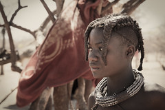 Red flag (carlos.aantunes) Tags: namibia africa namibian portrait tribe tribal tradition depia sepia people portraiture travel untouch namib himba canon 5d hair funny woman young tribes flag red