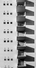 DSC_0179-3 (deborahb0cch1) Tags: monochrome building architecture blackandwhite pattern window square vertical blacony facade wall shadow