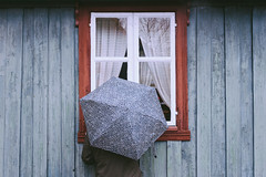 norwegian wood (19seconds) Tags: umbrella wall window woman nikon28mmf18 oslo norway travel portrait