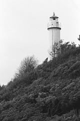 Lighthouse (Federico Pitto) Tags: bw nikkor135mm28 nikonfe2 trix d76 genova