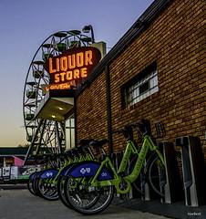 Cross at Lowry and Marshal (12story) Tags: bike downtown minneapolis liquor ferriswheel merrygoround marshal lowry