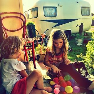 365/268 • home from a lovely night away, where the Smalls discovered water balloons • #2014_ig_268 #sunshine #porch #morningtonpeninsula #daylightsaving #4yo #6yo #vintagecaravan #vintagecaravanbackdrop