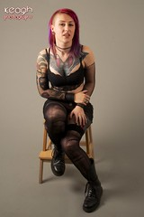 IMG_4278 (Neil Keogh Photography) Tags: red black stockings metal female belt punk sitting purple lace bra gothic earring piercing tattoos chain rings bracelet suspenders stool docmartens studioshoot rippedtights fishnettop docmartenboots modelholly sideshave