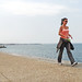 Macedonia, Thessaloniki, young woman walking fast along Thermaikos bay seafront #Μacedonia
