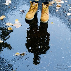 shoeless shadows (Tomitheos) Tags: autumn distortion reflection fall halloween wet puddle solitude boots invisible surrealism ghost nowhere deadleaves haunted creepy phantasm rainforestink tomitheosphotography october2014 shoelessshadows