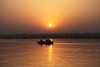 Boating on the River Ganges at dawn (Heaven`s Gate (John)) Tags: travel india reflection silhouette sunrise river landscape dawn boat atmosphere calm boating ripples ganges varanesi 25faves johndalkin heavensgatejohn