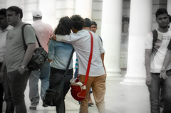 love birds in the busy connaught place (Prof EuLOGist) Tags: new friends india love walking hug couple place delhi casual connaught