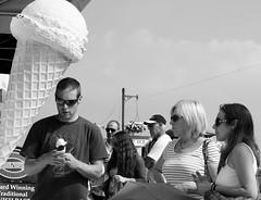 It's not as big (farwest56) Tags: street uk england blackandwhite man sunglasses 50mm mono women cornwall sony icecream stives a350 sal50f14