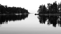 Sweden 2014 (SS) Tags: trees light sea summer sky holiday monochrome june sailboat reflections landscape photography boat pentax sweden stones branches 169 k5 2014 ss