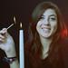 Tabby lighting a candle colour negatve photo