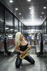 Es-scale-ator (DZ-fotografia - 15 Million views, Thx) Tags: sax saxophone alto sexy blonde woman lady long hair black lace leather station metro railway escalator