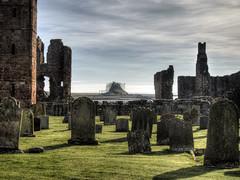 Lindisfarne Castle from the Abbey ruins (neilalderney123) Tags: ©2017neilhoward lindisfarne holyisland ruins castle graveyard landscape england olympus omd