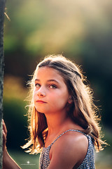 (Rebecca812) Tags: girl child overtheshoulder longhair rimlighting headandshoulders serious brownhair hazeleyes outdoors sunset sunlight naturallight portrait people beauty canon canon5dmarkii rebecca812