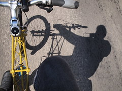 Cycling with my Shadow (cycle.nut66) Tags: bicyclle ride riding cycling moving road shadow cyclist space frame moulton yellow tsr27 tsr 27 small wheel full suspension olympus epl1 evolt micro four thirds handlebars stem pedalling movement