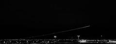 Takeoff (lamnn92) Tags: dfw airport aviation airplane building night takeoff lighttrail longexposure nightphotography dark sky bw cropped panasonic fz1000