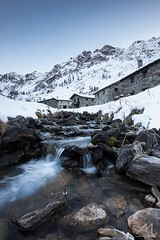 Winter in Case di Viso (Andrea Moraschetti Photography) Tags: ngc winter white snow ice water flow stream stones mountain landscapes mountains view house building summit park stelvio italy italian place color vallecamonica casediviso nature natural