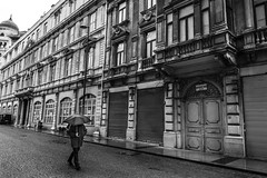 Rainy Day (㋡ Aziz) Tags: rain umbrella xt2 16mm street bw mono monochrome white black blackandwhite istanbul old new city eye view deep composition architecture fuji