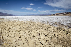 Cracked Soil at Badwater (lycheng99) Tags: crackedsoil cracked soil dry arid deathvalley deathvalleynationalpark badwater badwaterbasin blue sky bluesky mountains salt saltflats landscape nature hot