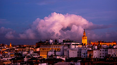 evening in Sevilla (www.nathalie-chatelain-images.ch) Tags: espagne spain andalousie andalusia séville sevilla soir evening ciel sky clouds nuages lumières lights toits roofs nikon ngc