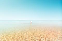 El sonido del agua en las orillas de tus rodillas (Ibai Acevedo) Tags: sea mar blue colorful water playa paradise spring summer clear isolated holidays seascape sound silence