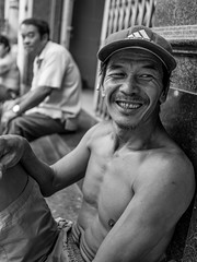 A manual worker (tumivn) Tags: smile blackandwhite a99ii zeiss1635 monochrome streetphotography street streetportrait