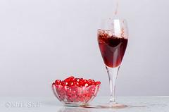 Pomegranate & Juice (khalilshah) Tags: red dark wine pomegranate fresh redwine splash spark tempting darkred freshfruit pomegranateseeds pomegranatejuice redliquid redseeds pomegranatewine temptingcolor