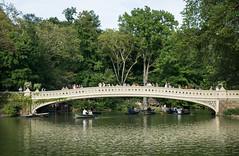 Bow Bridge (andyscho2004) Tags: nyc newyorkcity bridge trees summer usa ny newyork reflection green water america landscape boats nikon centralpark peaceful tourists bowbridge d7100