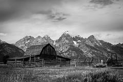 Mormon Row (Jo Duggan) Tags: bw usa white black mountains monochrome clouds barn nationalpark nps row mormon wyoming grandteton jacksonhole 2014 antelopeflats