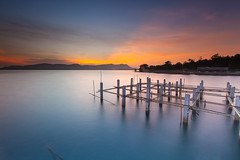 Winter Sunrise (baddoguy) Tags: longexposure seascape abandoned horizontal sunrise thailand outdoors photography images getty copyspace multicolored dramaticsky constructionsite affectionate incomplete fishery mountainrange tranquilscene colorimage chanthaburi beautyinnature constructionindustry focusonforeground focusonbackground sunrisedawn khungkraben aokhungkraben