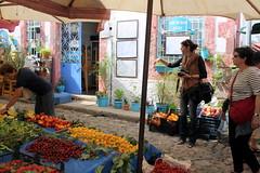 which way shall we go? (overthemoon) Tags: street people fruit turkey island market trkiye stall turquie trkei cunda ayvalik balikesir presstrip alibeyadasi