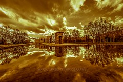 Reflection at the Temple of Debod, Madrid (Marco Carbone Photography) Tags: madrid sky sunset spain nikon sun clouds cielo tramonto viaggi spagna fotografia photooftheday temple reflection nature winter riflesso alberi trees water
