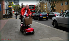 `1923 (roll the dice) Tags: london westminster harrowroad w9 man pavement old pensioner speed danger disabled mad sad funny surreal people natural wisdom streetphotography tourism rough canon unaware unknown portrait stranger candid bus traffic stowe basket shell gas petrol flats mobility shopping shops fashion weather londonist motorscooter motor smile happy red colour power