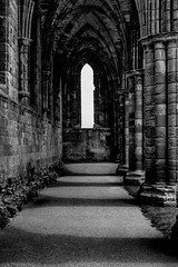 Shadows of the centuries (Anthony P26) Tags: architecture category decay england internal northyorkshire places travel whitbyabbey yorkshire britain british greatbritain english stonebuilding stone arches lightandshadow shadows gothicarchitecture architecturephotography travelphotography monochrome mono blackandwhite whiteandblack bw canon1585mm canon550d canon
